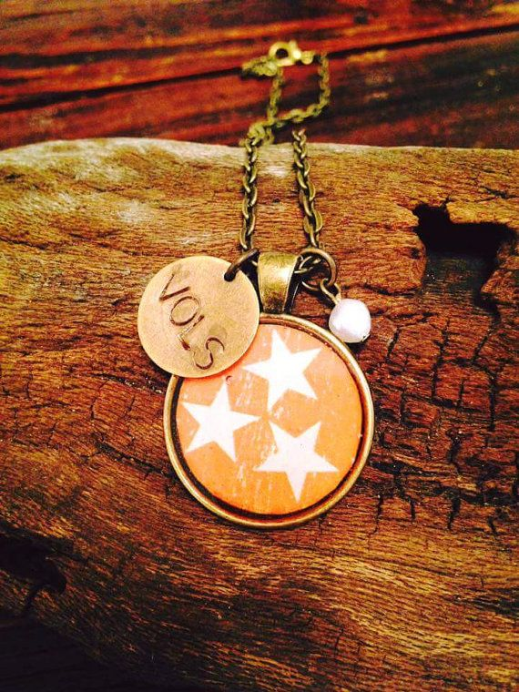 Orange Tri-Star Tennessee Necklace - show your love for Tennessee and the Vols with this beautiful tri-star necklace. Available in Blue/Bronze, Blue/Silver, Orange/Bronze,…