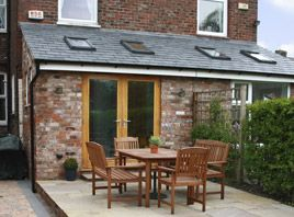 Tiled roof extension with Velux windows