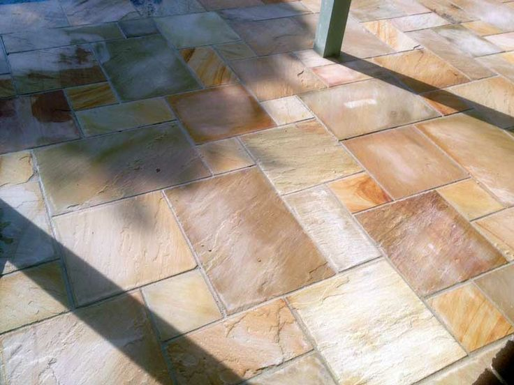 French Pattern style tiling. Sandstone tiles supplied by Gaia Stone, job performed by Grand Paving.