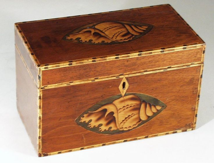 """A very good example of a mahogany veneered tea caddy with exceptionally robust shell inlay. A typical design of the last decade of the 18th century.    8.75"""" wide 4.75"""" deep 5.5"""" tall  Circa 1790  http://www.hygra.com/tc2/images1/0c0101.jpg"""