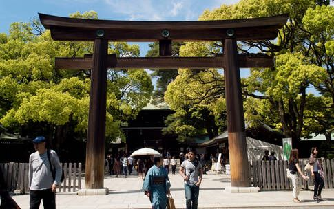 Local flavor: Finding silence at a shrine. Tokyoites seek peace at Meiji Shrine, a verdant escape from Shibuya's frenzy.