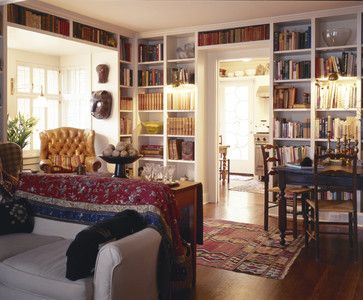 9 Decorating Trends to LOVE: #3 -- WALL OF BOOKS. Notice how the bookshelves appear even over the doorway and the large bay window.