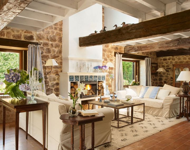 Stone walls and beams with slipcovered furniture!