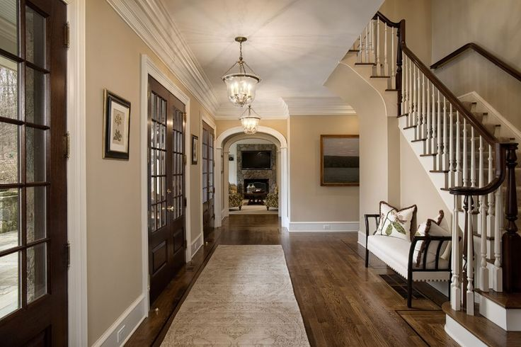 Traditional entryway with hardwood floors high ceiling for High ceiling entryway