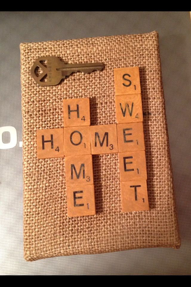 Craft. New home card - use scrabble tile stamps to make card on kraft paper.  Add home key from collection.