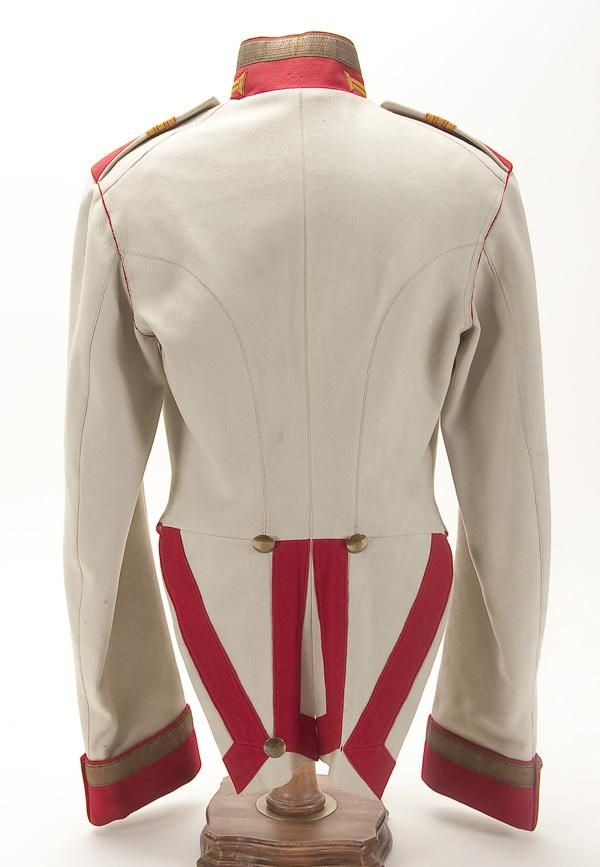 Back side of an Imperial Russian Horse Guard Cavalry Sergeant's ceremonial coatee, circa 1910. Double breasted white wool tail coat with red facings. With orange and red Litzen and gold bullion braid on the collar and cuffs. Complete with red shoulder straps with white piping and three rank bars. A turn-of-the-century copy in the style of an 1812 - 1814 era uniform used for commemorative ceremonies.