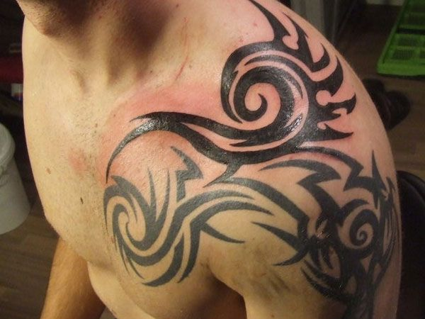 tribal on the shoulder 30 Oustanding Tribal Shoulder Tattoos