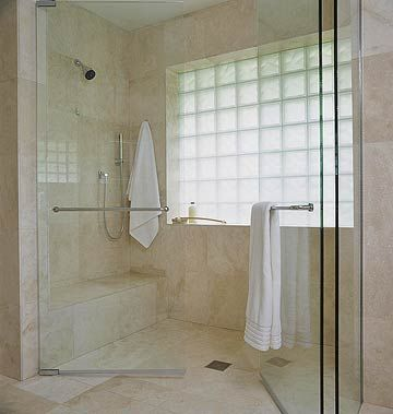 Master Bathroom - Shower View - Simple yet functional and beautiful just as design should be.  A marble shower with dual, in-swing clear shower doors.  Not everbody needs lots of fancy shower heads, sprays and jets when one will do! The large glass block window allows a bounty of filtered light yet provides adequate privacy. #bhg.com