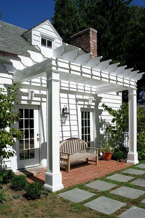 This white pergola would look great on the back of our white home! off of the 2nd patio