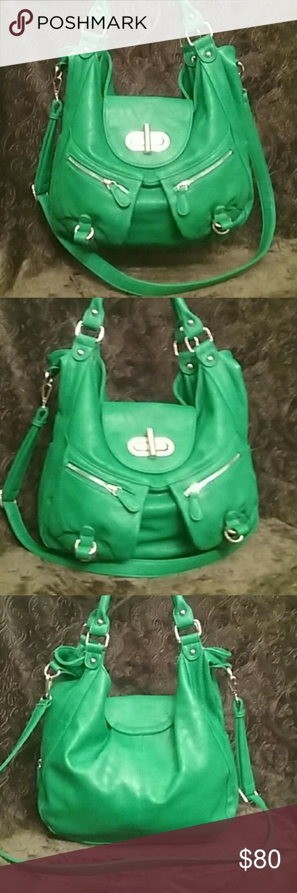 Melie Bianco Expandable Vegan Handbag - NWOT Authentic Melie Bianco Alyssa Expandable Purse. Emerald green, vegan leather hanbag, crossbody strap, lots of space extra large, outside zips open for even larger look and space. Very unique and popular bag. New without tags! Melie Bianco Bags Crossbody Bags