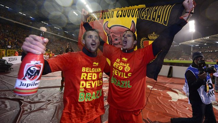 "Belgium's national football team Kevin Mirallas and Daniel Van Buyten (R) wearing red tee shirts reading ""Belgian Red Devils in Brazil""."