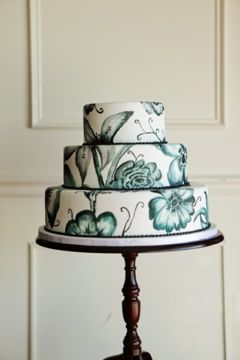 This cake was inspired by a dress I saw in a New York window display!  I love it!  So pretty! All hand painted with gel colors.