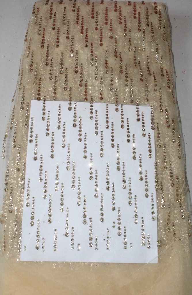 GLITTER ON NET FABRIC
