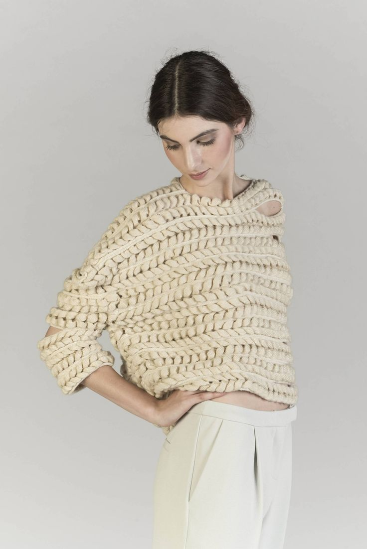 A collection focused on the use of British wool, utilizing different sheep breeds and showcasing their unique fibre qualities. Taking traditional cable knitting techniques as a starting point, the collection develops intricate structures inspired by natural and architectural forms. Hand knitting, machine knitting embellishment and crochet, alongside dying with natural extracts has been explored throughout to create diverse texture and scale.