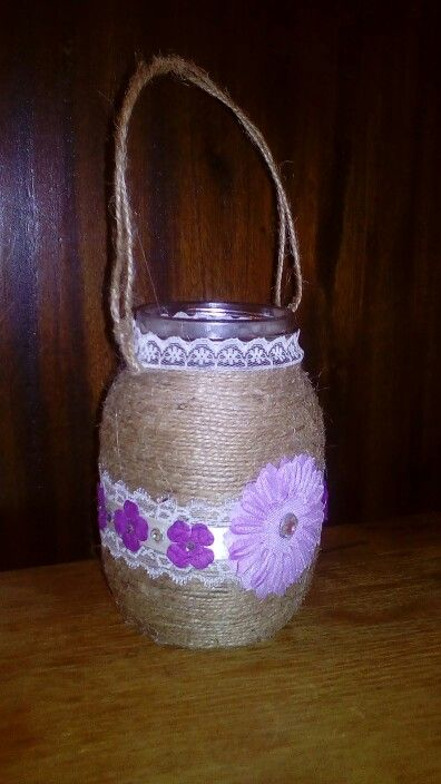 Twine and flowers hanging mason jar candle holder