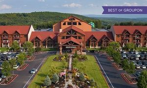Groupon - Stay with Daily Water Park Passes and Breakfast at Great Wolf Lodge Pocono Mountains in Pennsylvania. Dates into April. in Pocono Mountains, PA. Groupon deal price: $149