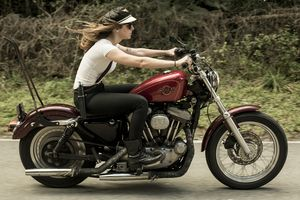 Kasey of the Iron Lilies shot by Womens Moto Exhibit Women Who Ride. Harley Davidson.
