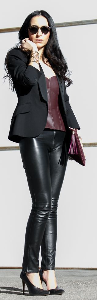 Leather on leather head to toe is usually too aggressive but with adding a simple blazer to it it softens the edgy look and makes it more uptown.