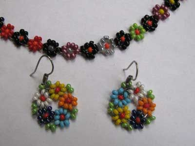 daisy chain earrings - I love daisy chains. WIsh the picture was better.