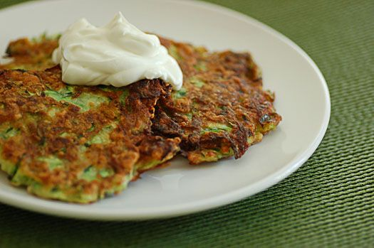 zucchini fritters with goat cheese topped with sour cream. sounds ...