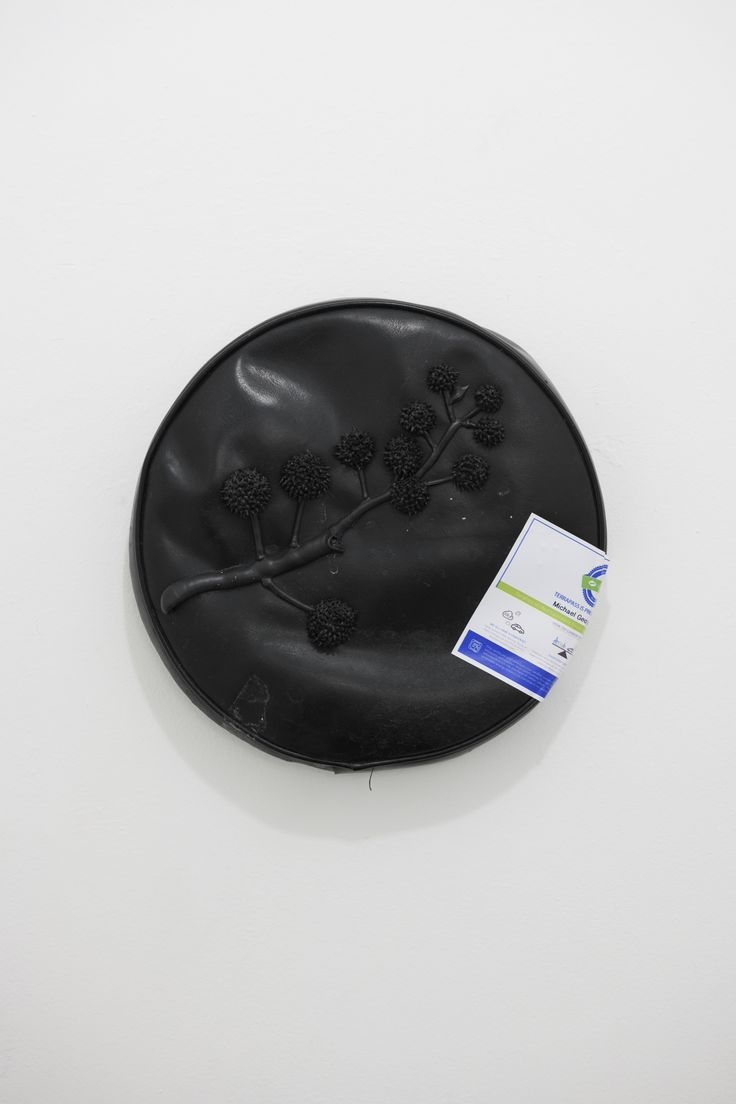 """Michael Assiff Cap and Trade plastic and Terrapass voluntary carbon offset certificate on pleather stool seat 12"""" round"""