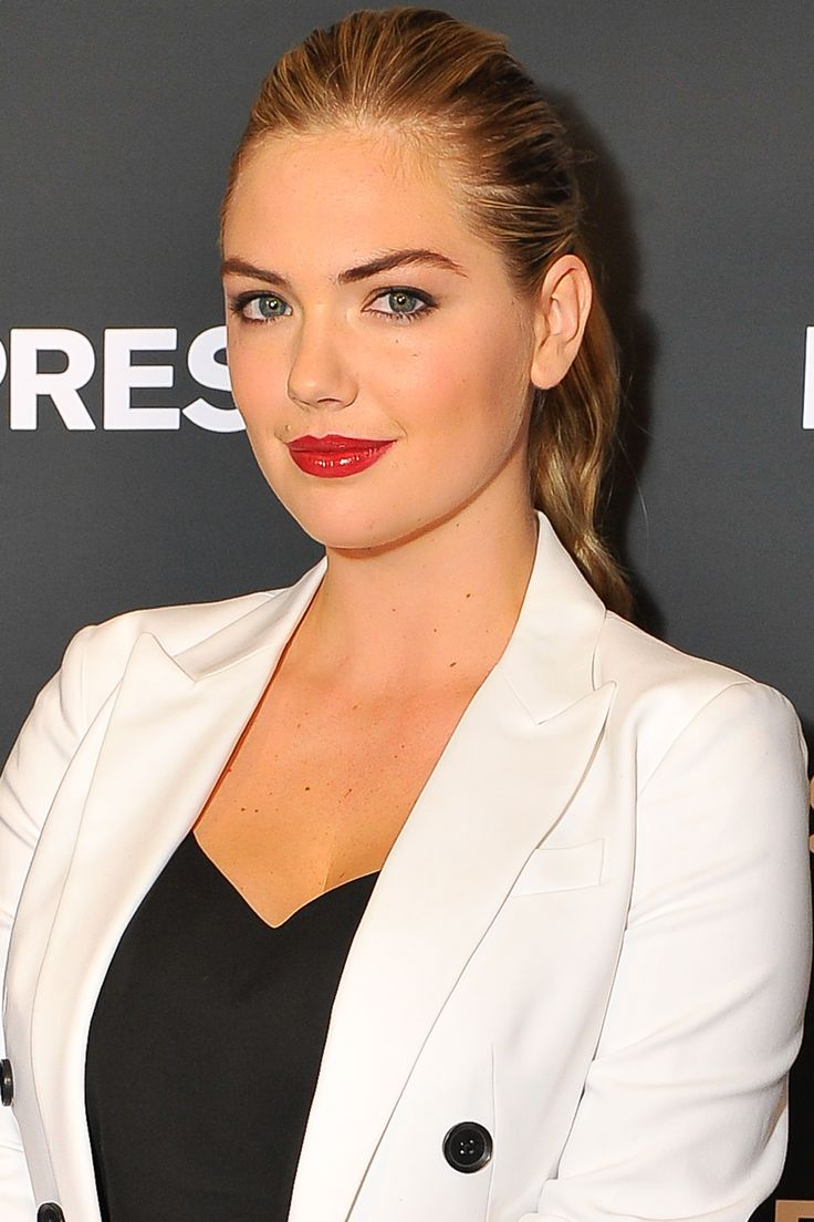 Who: Kate Upton What: Modern Glamour How-To: The model looked classic and youthful in black and white, a neat ponytail and high-shine lips. To get ultrarich, opaque color, layer a blue-red gloss over orangey-red lipstick. Editor's Pick: Bobbi Brown Lip Color in Lady Ruba and Lip Gloss in   - HarpersBAZAAR.com
