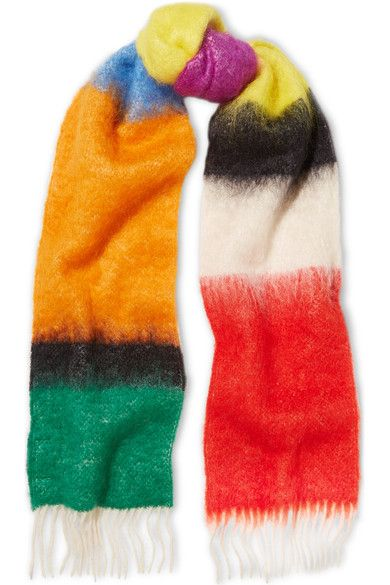 """If you're going to embrace the cult of the colorful accessory, there's no point in doing it half-heartedly,"" says The EDIT. Made from fuzzy mohair and wool-blend, Loewe's rainbow-hued scarf is perfect for adding a dose of saturation to off-duty looks."