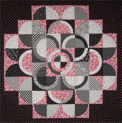 Circle of Hope Quilt Pattern SM-108- If you would like a template to make construction of this quilt easier, Nancy Elliott MacDonald sells them on her on-line store at http://www.nancymac.com/shopping/curves.html#shopping_area
