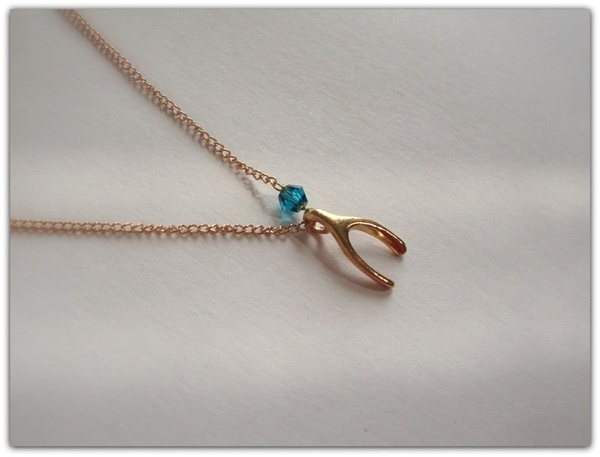 I found 'A Tiny gold wishbone necklace ,with a blue zircon swarovski crystal.' on Wish, check it out!