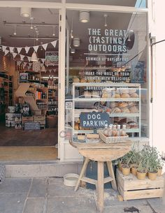 """Daylesford, London: this shop in Notting Hill has a great vibe of the classic organic local general store. Check out the """"dog parking"""" sign and water bowl"""