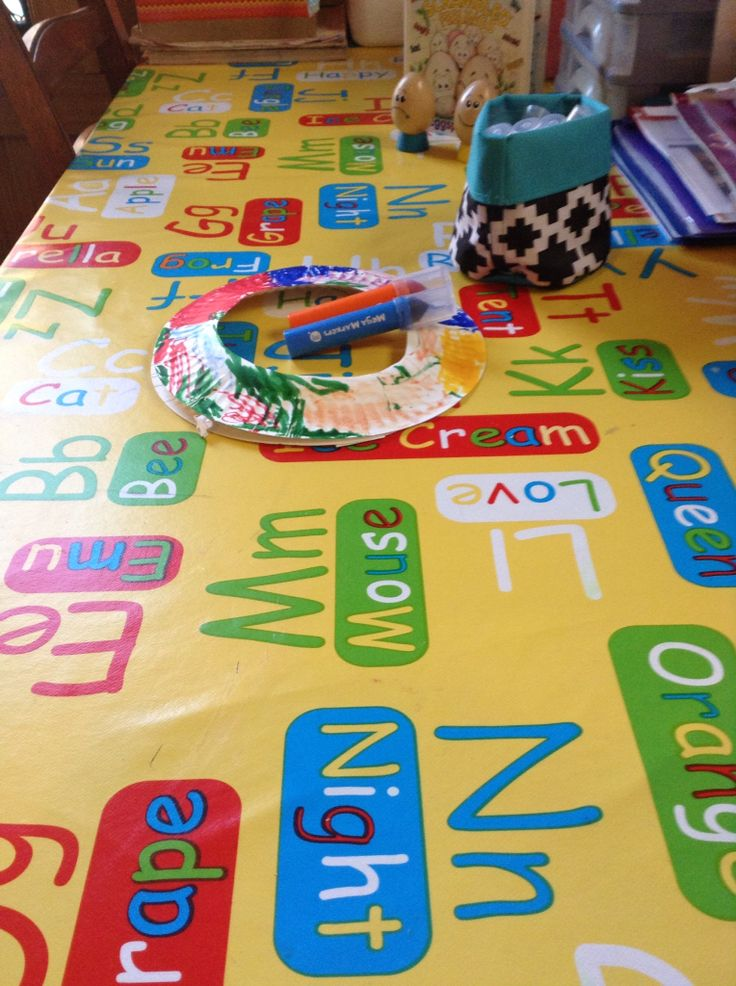Easy wipe down tablecloth for learning letters while busy at the table