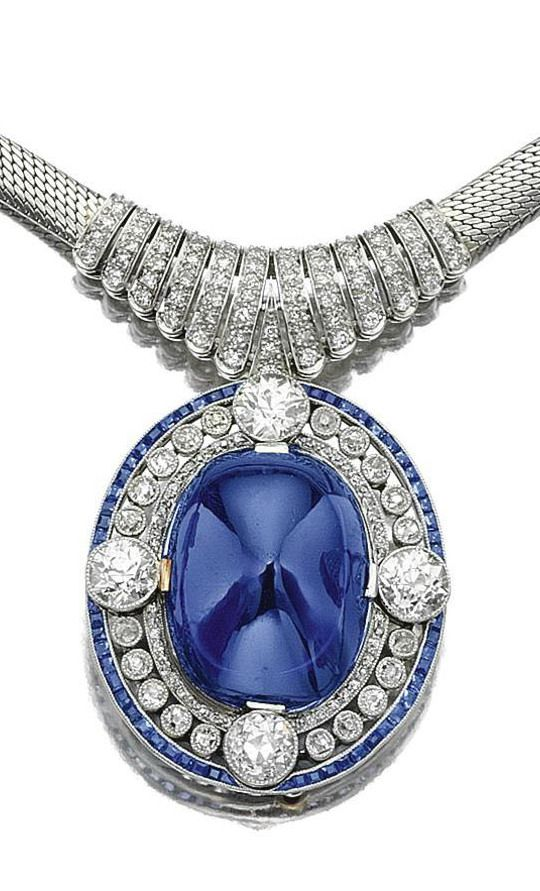 Sapphire and diamond pendent necklace, circa 1910, composite. The pendant with…