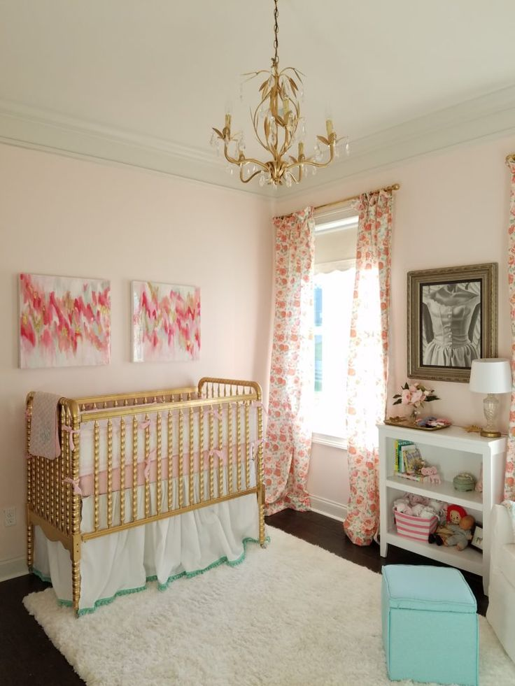 Modern florals and fun in this peach-y pink designed little girl's nursery.