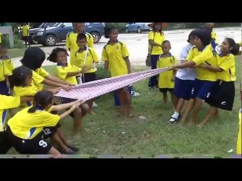 Village kids test if Thai silk scarves are fragile