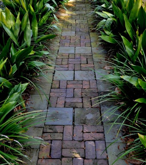 mix brick with concrete pavers = good way to widen a narrow brick path, or stretch your supply of bricks, and make it look like you meant to do it that way.