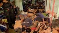 The BBC witnesses a prison raid in one of Manila's biggest jails - the latest offensive in Philippine President Rodrigo Duterte's war on drugs.