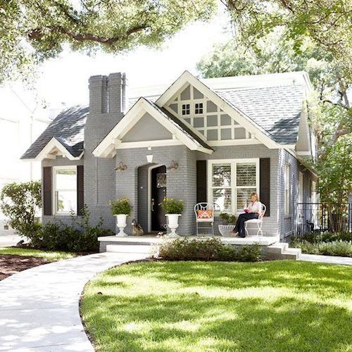 This painted brick home is so fresh and new looking. They owners did a lovely job. Great accents with the white trim and black shutters. LOVE!