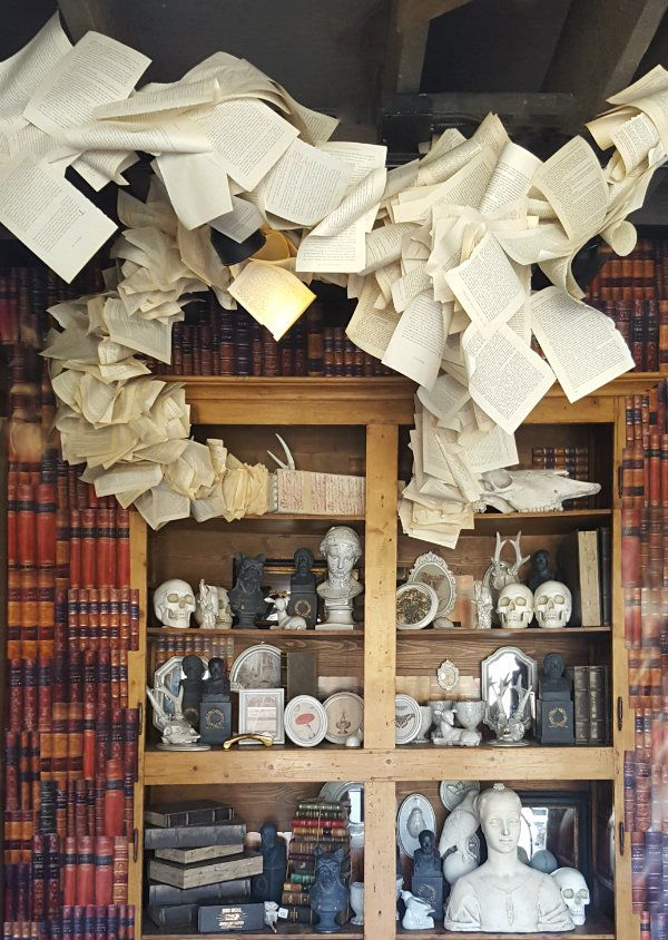 HALLOWEEN HAUNTED MANSION | As you enter, you'll see fluttering book pages that come alive with the words and stories of Grimm Tales!