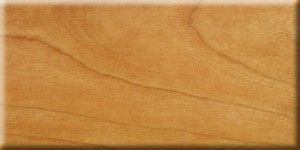 Solid cherry with oil finish.