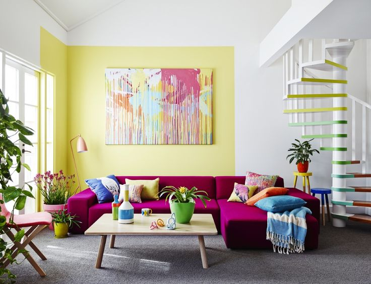 The bright colours in this living area are cheerful  and work perfectly with the citrus yellow feature wall. The use of Analogous colours on the stair profile is very clever and effective. Photo credit: dulux.com.au