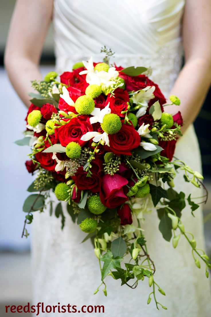 Lovely colours for a Christmas, winter, Valentine's wedding. Or for a bride who just loves the colour red! Designed exclusively by our highly experienced designers. reedsflorists.com