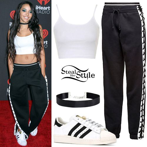 Tinashe attended the 2016 iHeartRadio Music Festival in Las Vegas wearing a Topshop Cropped Ribbed Cami Vest ($10.00), Fenty Puma by Rihanna Lacing Sweatpants ($150.00), a satin choker like this from ASOS ($8.50) and Adidas Originals Superstar Sneakers ($80.00).