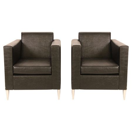 Set of two Stakck midcentury leather chairs with raised front chrome feet.  Product: Set of 2 chairsConstruction Mat...