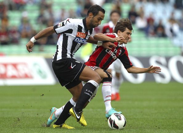 Medhi Benatia of Udinese Calcio competes for the ball with Krkic Bojan of AC Milan during the Serie A match between Udinese Calcio and AC Milan at Stadio Friuli on September 23, 2012 in Udine, Italy