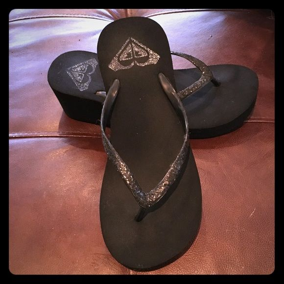 Glitter Wedge Platform Flip Flops Black glitter Roxy wedge platform flip flops.  Only worn a few times.  Lots of life still in these cuties. Roxy Shoes Sandals