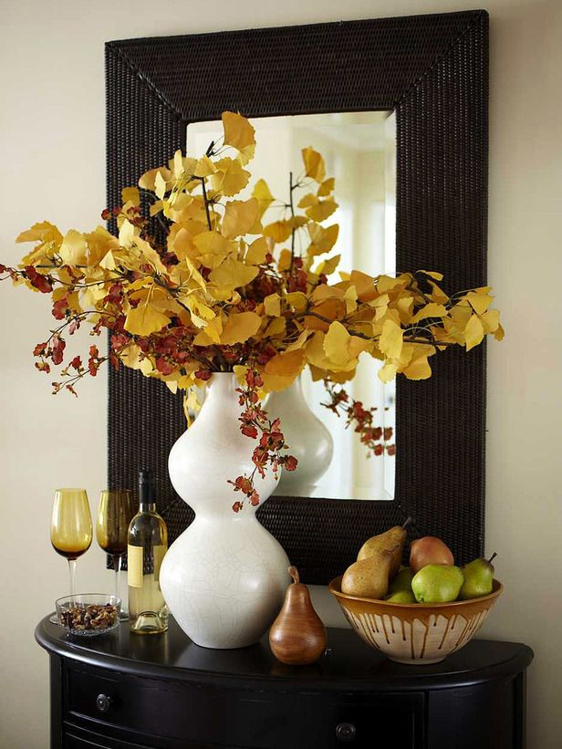 Mirror and tavle entrance way. Warm Welcome: Entryway With Autumn Colors. http://www.hgtv.com/decorating-basics/our-favorite-fall-decorations/pictures/page-11.html?soc=pinterest