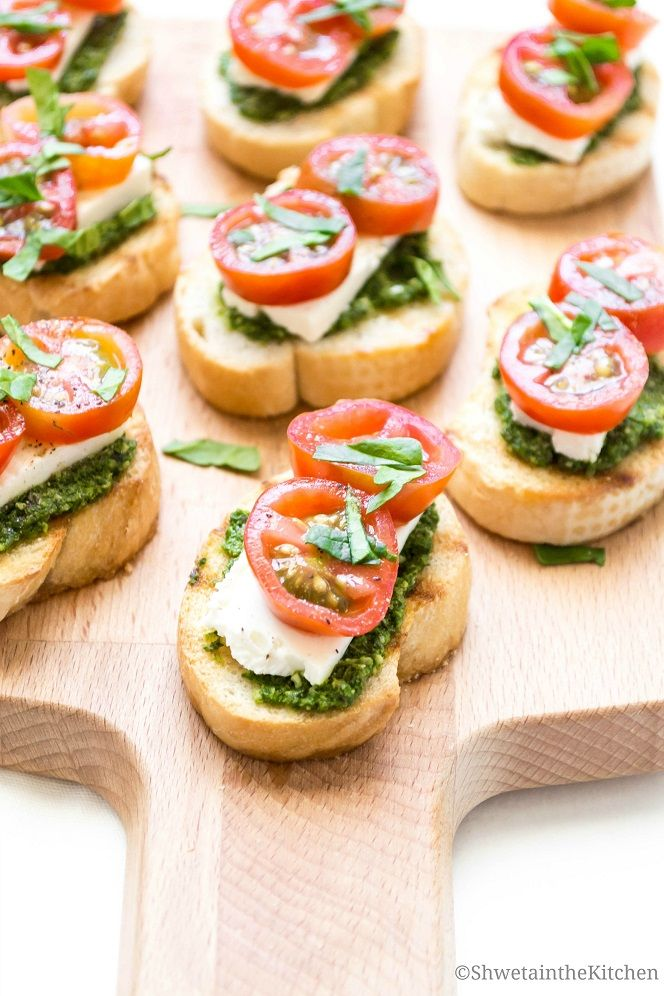 A quick, easy and flavorful appetizer made with bread, Pesto, cream cheese and tomatoes.