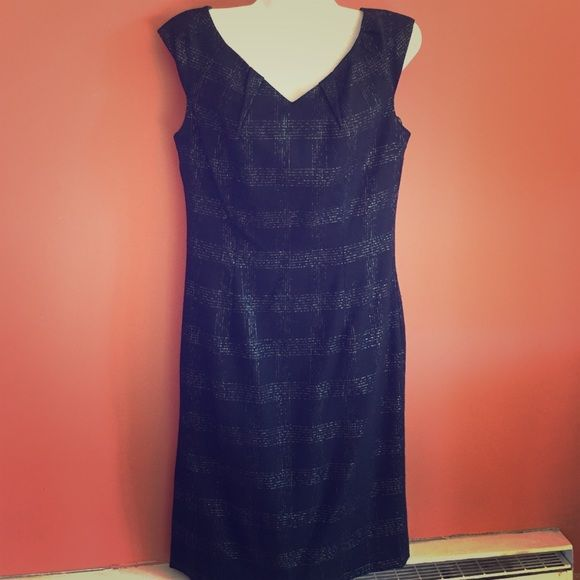 Black and Silver work dress Perfect for the office. This dress is black with silver accents and pleated chest line. Very comfortable Moschino Dresses