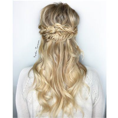 Kirstin T looks breathtaking in this braided bridal updo. Snag her 'do with this how-to.