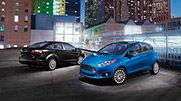 The 2015 Fiesta Titanium sedan shown in Tuxedo Black on the left and the 2015 Fiesta Titanium hatchback shown in Blue Candy Metallic Tinted Clearcoat on the right.